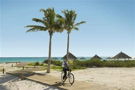 Sandals Emerald Bay Golf Tennis and Spa Resort Butler On Bike