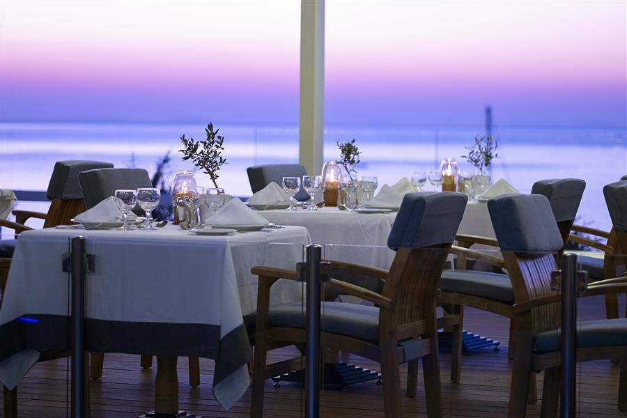 Restaurant with sea view at sunset