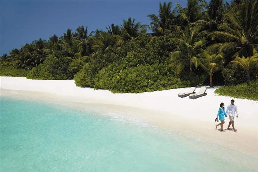 Shangri La Villingili Resort  and Spa Couple On Beach