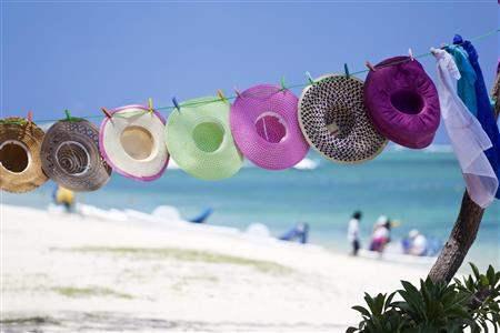 Mauritius colourful hats on tropical beach