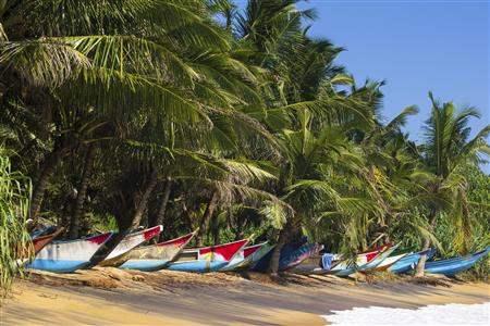 Full Boats parked on Mirissa beach in Sri Lanka