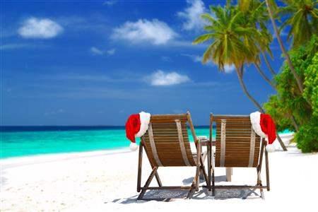 Christmas chairs on a white tropical beach