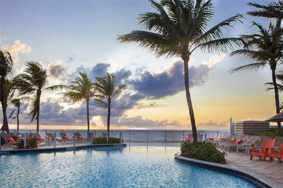 Pelican Grand Beach Resort Pool Sunset